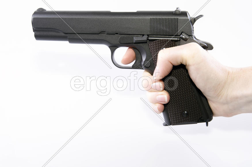 hand holding a gun on a white background isolated