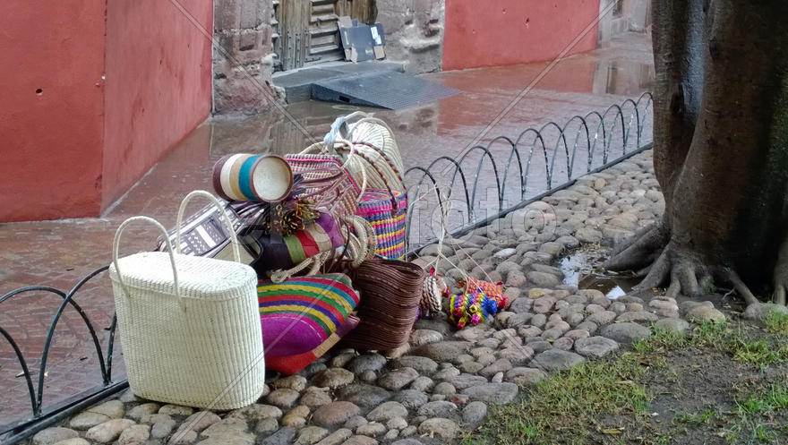 Traditional Mexican bags lying on the ground