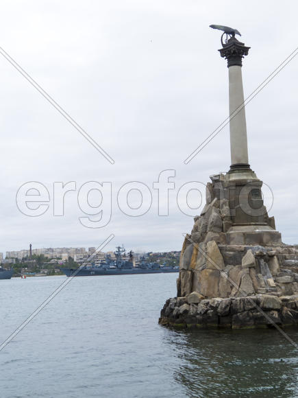 Monument to the flooded Russian ships in a bay
