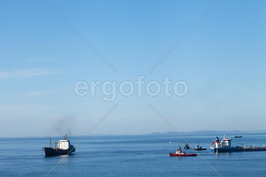 Seascape with ships and mountains on the horizon a bright sunny day