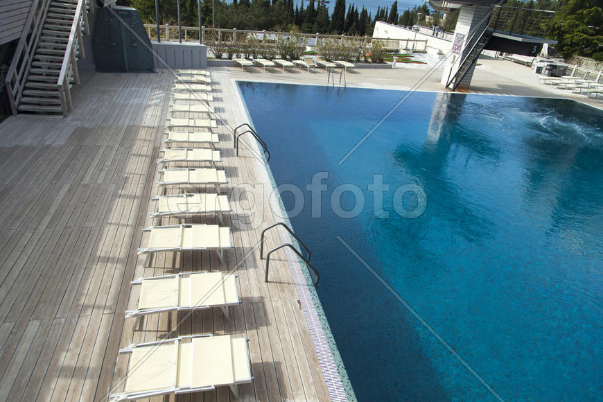 The swimming pool under beams of the sun is ready to competitions and rest