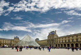 Crowded area near the Louvre glass pyramid in the courtyard of Napoleon in ParisCrowded area near th