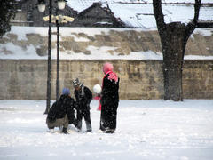 Children making a snowman in Istanbul