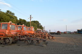 Russia, Temryuk - 15 July 2015: Tractor, standing in a row. Agricultural machinery. Parking of agric