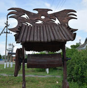 Wooden well for yard decorations. Wooden decorations