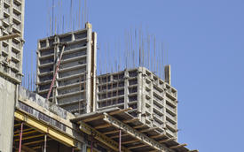 Construction of a multistory building. Installation of the concrete walls of the building.