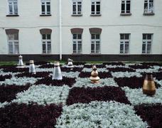 Decorative chess pieces on a bed in the center of Bobruisk