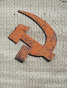 Hammer and sickle on the wall of an apartment house in city of Rostov