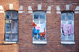Dorm window with drying laundry in the winter
