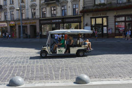 A little courtesy car. Cobblestones on the pavement of the city