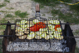 Pickled vegetables grilled over charcoal on the grill