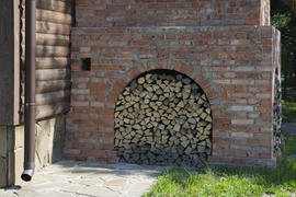 Firewood stacked near the stove near a private house
