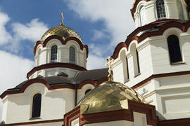 The orthodox church sparkles on the sun the gold domes
