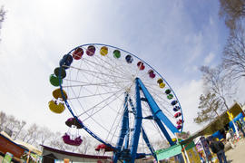 The big wheel in park pleases children and waits for them for driving