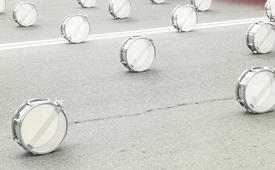 Drums on asphalt wait for drummers for march