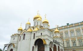 The orthodox church in cloudy weather lights the world with the domes